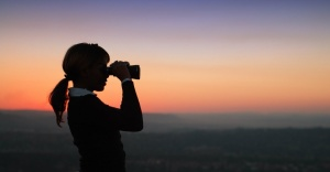 12654-binoculars-silhouette-woman-look-search-sky.1200w.tn